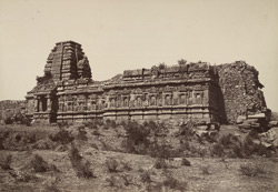 Purudkul. Ruined temple built into the village wall. [Papanatha Temple, Pattadakal.]